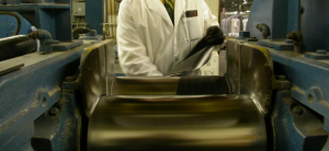 Chemist Operating a Sheet Rubber Thickness Testing Machine