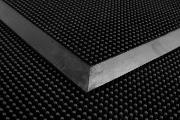 Close Up of Black Rubber FingerTrac Shoe Cleaning Rubber Mat