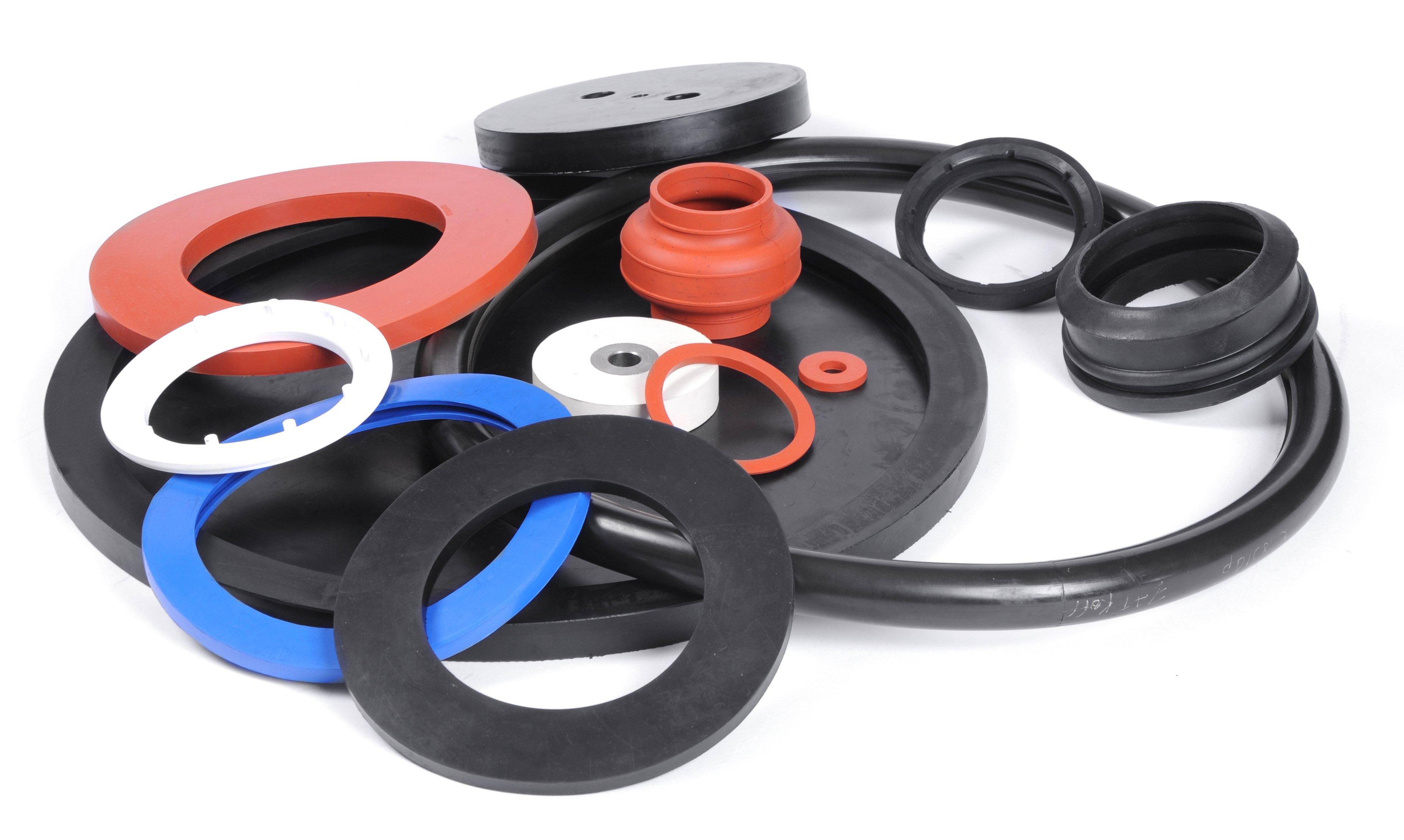 Examples of Molded Gaskets in a Blue, Orange, and Black Colors