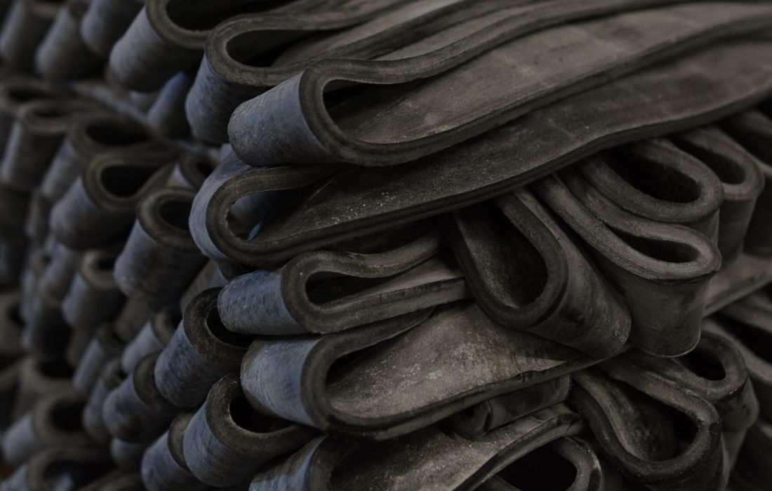 Close Up Front View of Black Rubber Stock Material in Strips